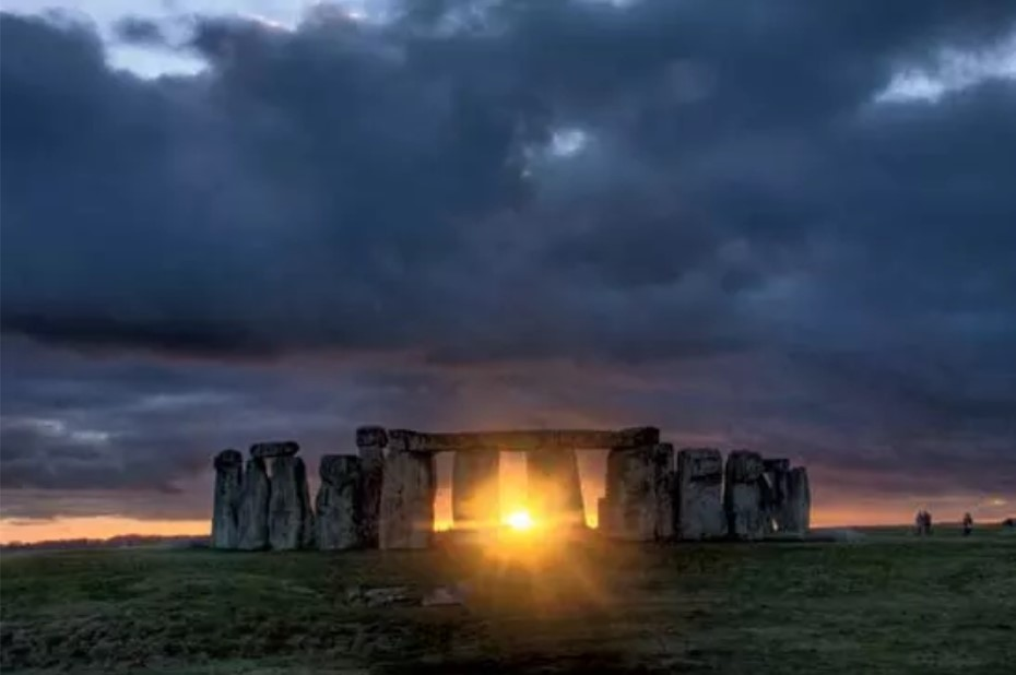The sun rising through Stonehenge, from Around and About Bath