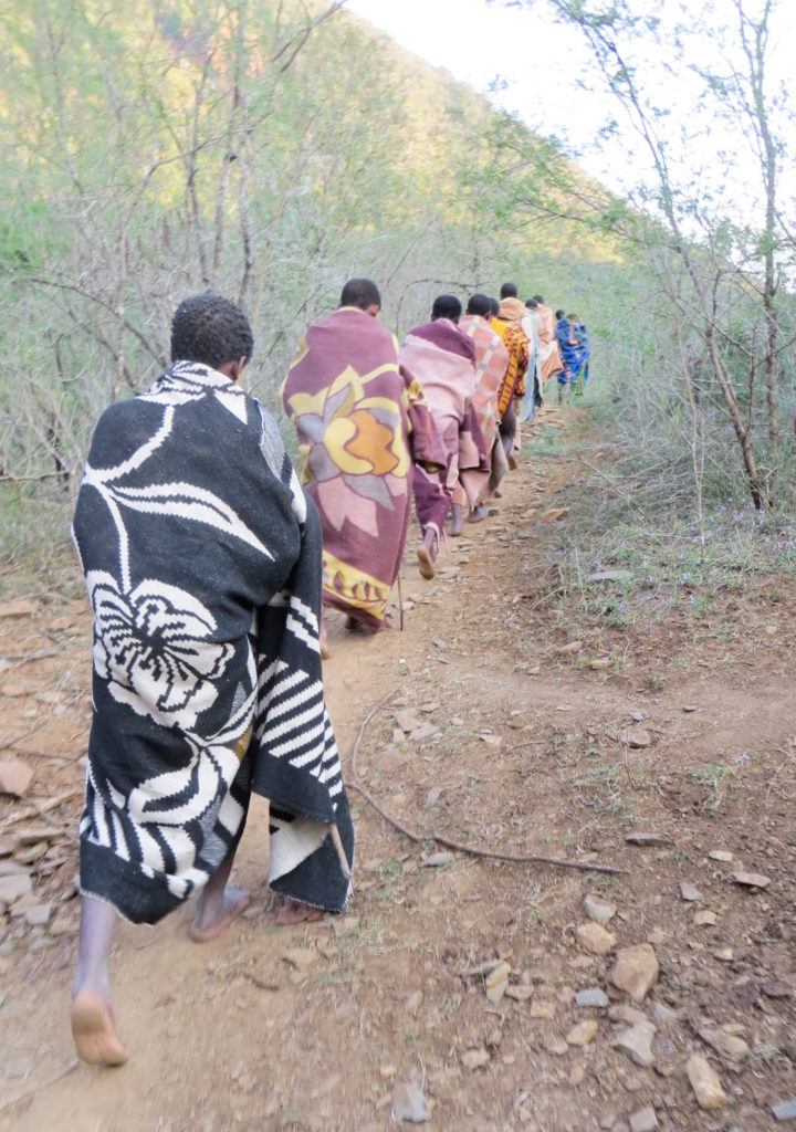 Xhosa walking through forest to their adulthood rite. They are neither boys nor men. (Photo by Dingeman)